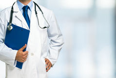 Doctor holding a clipboard Stock Images
