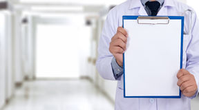 doctor holding a clipboard Hands of Health care medical backgro Royalty Free Stock Photo