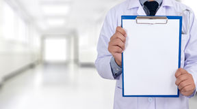 doctor holding a clipboard Hands of Health care medical backgro Stock Photography