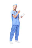 Doctor holding clipboard and look up Stock Photography
