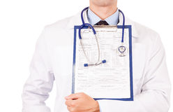 Doctor holding clipboard Stock Photography