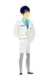 Doctor holding clipboard with papers. Stock Image