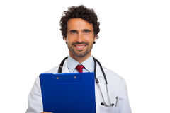 Doctor holding a clipboard Stock Photography