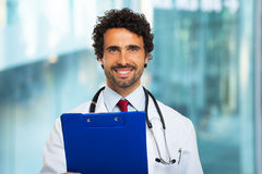 Doctor holding a clipboard Royalty Free Stock Images