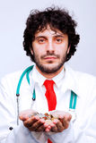 Doctor holding coins in his hands Stock Photos