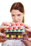 Doctor holding colorful pills Royalty Free Stock Photos
