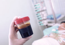 Doctor holding container in the patient's room Royalty Free Stock Photography