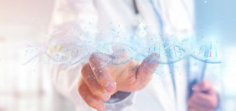 Doctor holding a 3d render DNA royalty free stock photos