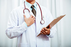 Doctor holding a data record Stock Image