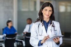 Free Doctor Holding Digital Tablet At Meeting Room Royalty Free Stock Images - 164999229