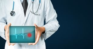 Doctor Holding Digital Tablet With Heart Beat. Modern Technology In Medicine Concept Stock Image