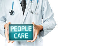 Doctor Holding Digital Tablet With Inscription People Care. Modern Technology In Medicine Concept Stock Photography