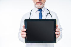 Doctor holding digital tablet. Partial view of male doctor holding digital tablet with blank screen Royalty Free Stock Image