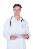 Doctor holding digital tablet Royalty Free Stock Photography