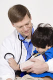 Doctor holding a disabled little boy Royalty Free Stock Photos
