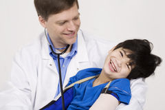 Doctor holding a disabled little boy Stock Photo