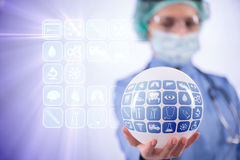 The doctor holding earth in global medicine concept Stock Photos