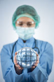 The doctor holding earth in global medicine concept Stock Image