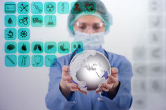 The doctor holding earth in global medicine concept Royalty Free Stock Photos
