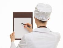 Doctor holding empty clipboard and a pen Royalty Free Stock Photos