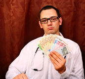 Doctor holding euro money Royalty Free Stock Images