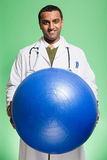 Doctor holding an exercise ball Royalty Free Stock Photo