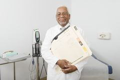 Doctor Holding Files And Documents At Clinic Royalty Free Stock Photography