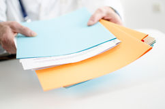 Doctor holding files Stock Images