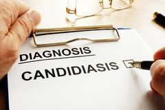 Doctor holding form with Candidiasis. Doctor is holding form with Candidiasis stock image