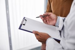 Doctor is holding form in his hand royalty free stock photos