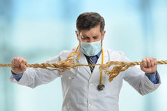 Doctor Holding Frayer Rope royalty free stock photos