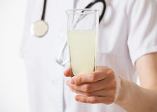 Doctor holding a glass with drug Stock Image