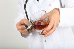 A Doctor holding a glass of Whisky Royalty Free Stock Photo
