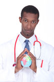 Doctor holding globe Royalty Free Stock Photo