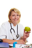 Doctor holding a green apple Stock Image