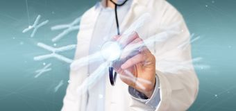Doctor holding a Group of chromosome with DNA inside on. View of a Doctor holding a Group of chromosome with DNA inside on a background 3d rendering royalty free stock photos