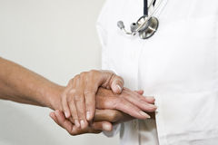 Doctor holding hand Royalty Free Stock Image