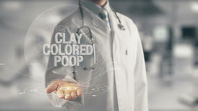 Doctor holding in hand Clay Colored Poop. Concept of application new technology in future medicine stock footage