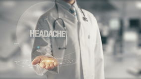 Doctor holding in hand Headache. Concept of application new technology in future medicine Royalty Free Stock Photography