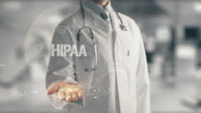 Doctor holding in hand HIPAA. Concept of application new technology in future medicine