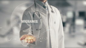 Doctor holding in hand Migraines stock video footage
