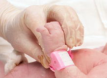 Doctor holding the hand of a newborn Royalty Free Stock Image