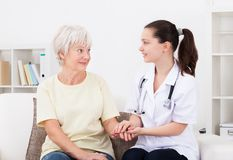 Doctor holding hand of patient Royalty Free Stock Image