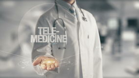 Doctor holding in hand Tele-Medicine. Concept of application new technology in future medicine Stock Image