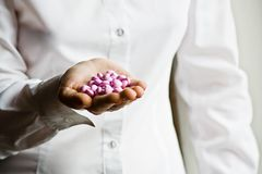 A doctor holding a handful of vitamin supplement Stock Images