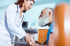 Doctor holding hands of patient Royalty Free Stock Photos