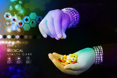 Doctor holding in hands pills Royalty Free Stock Photo