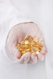 Doctor holding heap of pills Royalty Free Stock Photo