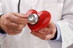Doctor holding heart Stock Photography