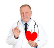 Doctor holding heart, friendly guy Stock Image